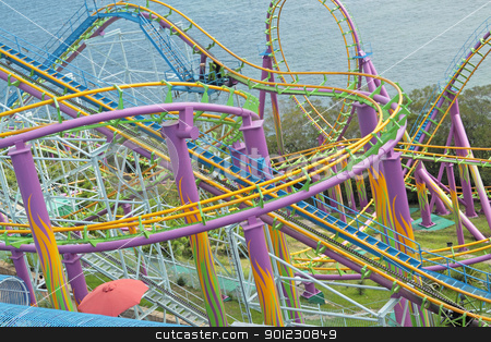 rollercoaster at amusement park stock photo, rollercoaster at day by Keng po Leung