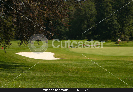 Golf Course stock photo, Golf Course in Forest - Golf Green With Flag and Bunker - Sand Trap by JAMDesign