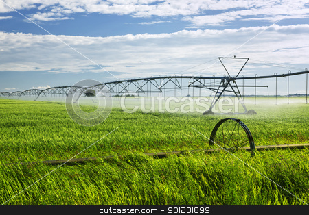 Irrigation equipment on farm field stock photo, Industrial irrigation equipment on farm field in Saskatchewan, Canada by Elena Elisseeva