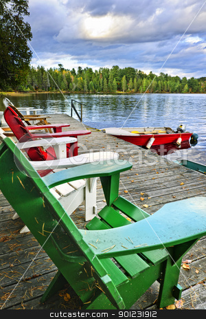 Deck chairs on dock at lake stock photo, Deck chairs at dock on Lake of Two Rivers in Algonquin Park, Ontario, Canada by Elena Elisseeva