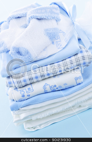Baby boy clothes stock photo, Stack of blue infant clothing for baby shower by Elena Elisseeva