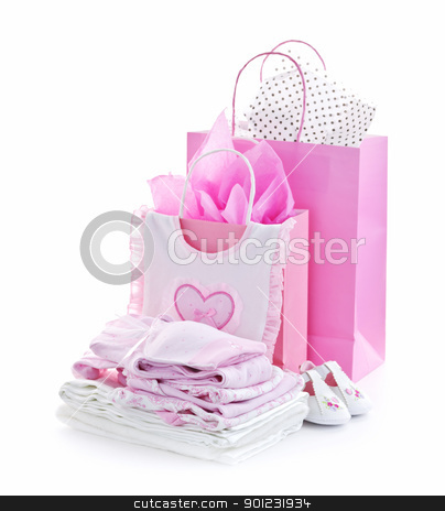 Pink baby shower presents stock photo, Pink gift bags and infant clothes for girl baby shower isolated on white by Elena Elisseeva