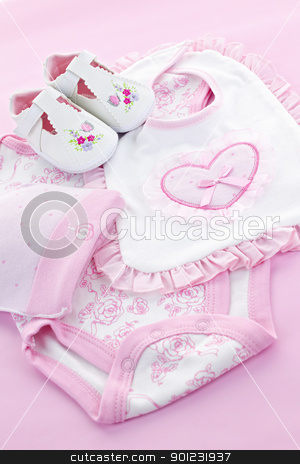 Pink baby clothes for infant girl stock photo, Pink infant girl clothing for baby shower by Elena Elisseeva