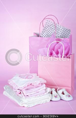 Pink baby shower presents stock photo, Gift bags and infant clothes for girl baby shower on pink background by Elena Elisseeva