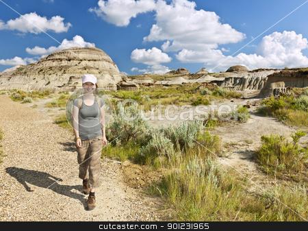 Hiker in badlands of Alberta, Canada stock photo, Happy girl hiking the Badlands in Dinosaur provincial park, Alberta, Canada by Elena Elisseeva