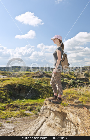 Hiker in badlands of Alberta, Canada stock photo, Happy female hiker looking onto the Badlands in Dinosaur provincial park, Alberta, Canada by Elena Elisseeva