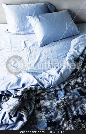 Unmade bed and bedding stock photo, Unmade messy bed with wrinkled sheets from above by Elena Elisseeva