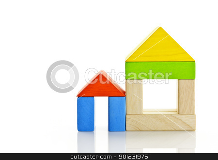 Wooden blocks houses stock photo, Houses built out of toy wooden building blocks by Elena Elisseeva
