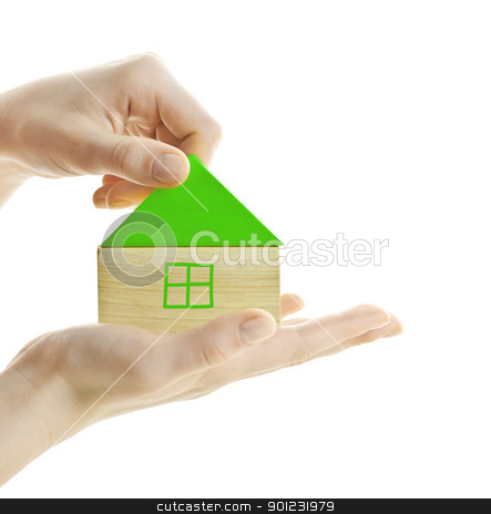 Green wooden block house stock photo, Hand holding green wooden block house isolated on white by Elena Elisseeva