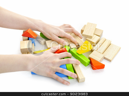 Hands with wooden block toys stock photo, Hands with pile of wooden block toys isolated on white by Elena Elisseeva