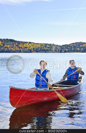 Family canoe trip stock photo, Father and daughter canoeing on Lake of Two Rivers, Ontario, Canada by Elena Elisseeva