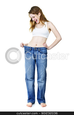 Happy girl in jeans after losing weight stock photo, Excited fit young woman in loose old jeans after losing weight isolated on white by Elena Elisseeva