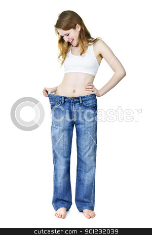 Happy girl in jeans after losing weight stock photo, Smiling fit young woman in loose old jeans after losing weight isolated on white by Elena Elisseeva