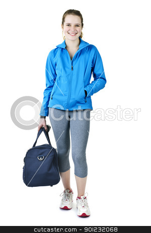 Athletic girl with gym bag ready for workout stock photo, Smiling fit young woman with gym bag standing ready for fitness exercise by Elena Elisseeva