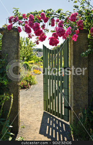 Open garden gate with roses stock photo, Pink roses hanging over open garden gate entrance by Elena Elisseeva