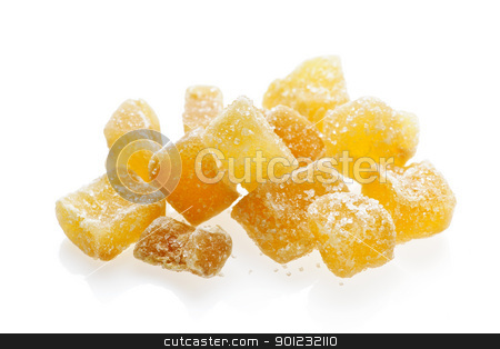 Candied ginger pieces stock photo, Caramelized ginger candy pieces isolated on white background by Elena Elisseeva