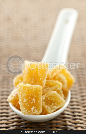 Candied ginger pieces in spoon stock photo, Caramelized ginger candy pieces on white spoon close up by Elena Elisseeva