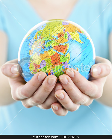 Hands holding globe stock photo, Globe of the planet Earth held in young female hands by Elena Elisseeva