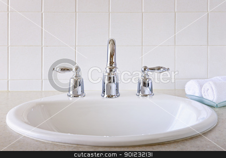 Bathroom sink stock photo, Bathroom interior with white sink and faucet by Elena Elisseeva