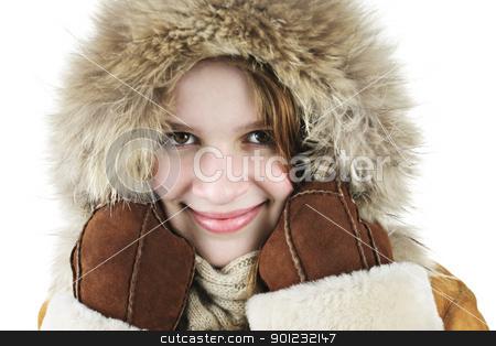 Happy winter girl stock photo, Beautiful young woman in fur hood of winter coat by Elena Elisseeva