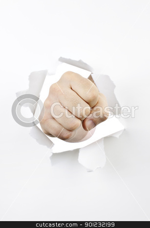 Fist punching through hole in paper stock photo, Fist punching through hole in white paper by Elena Elisseeva