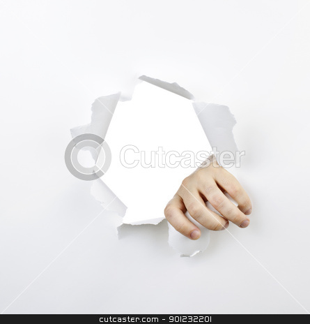 Hand ripping through hole in paper stock photo, Hand ripping a hole with torn edges in white paper by Elena Elisseeva