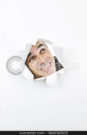 Face looking up through hole in paper stock photo, Curious man looking up through hole ripped in white paper by Elena Elisseeva