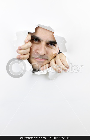 Face looking through hole in paper stock photo, Hole in paper with angry man looking through by Elena Elisseeva