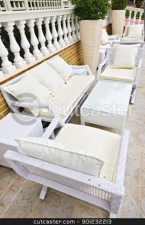 Patio furniture outdoor stock photo, Wicker patio furniture outdoor in area paved with natural stone by Elena Elisseeva