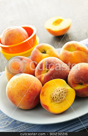 Peaches on plate stock photo, Ripe juicy peaches on a plate ready to eat by Elena Elisseeva