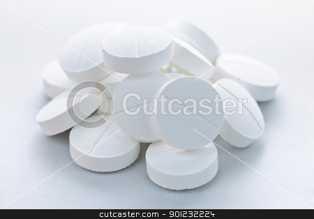 Calcium tablets stock photo, Calcium supplement pills in a pile closeup by Elena Elisseeva