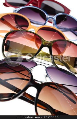 Sunglasses stock photo, Assorted styles of tinted sunglasses on white background close up by Elena Elisseeva