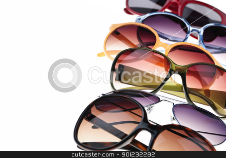 Sunglasses stock photo, Assorted styles of tinted sunglasses on white background by Elena Elisseeva