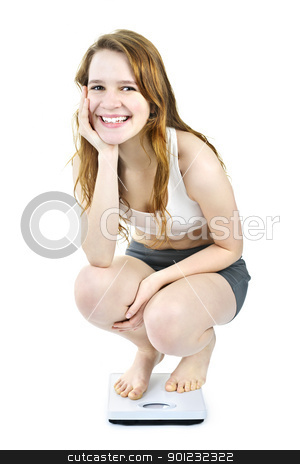 Smiling young girl on bathroom scale stock photo, Healthy happy young woman crouching on bathroom scale isolated on white by Elena Elisseeva