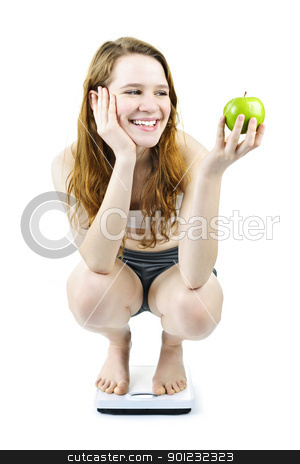 Young smiling girl on bathroom scale holding apple stock photo, Healthy happy young woman holding apple on bathroom scale isolated on white by Elena Elisseeva