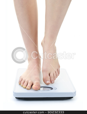 Feet on bathroom scale stock photo, Bare female feet standing on bathroom scale by Elena Elisseeva