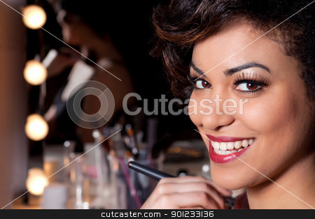 Young Woman Makeup Session Portrait stock photo, Young attractive woman with  beautiful smile, long eyelashes and red lips closeup portrait. by Rognar