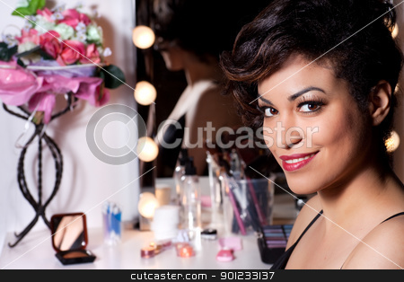 Fashion Beauty Portrait of a Sexy Woman stock photo, Beautiful sexy smiling young woman portrait. Makeup table in the background. by Rognar
