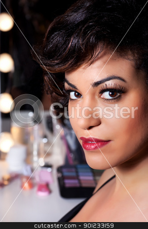 Beautiful Woman with Full Makeup Portrait stock photo, Backstage beauty shoot of a young woman with big brown eyes long eyelashes and cherry red lips. by Rognar