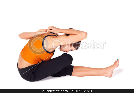 Fit Woman Practicing Yoga Stretching Asana stock photo, Fit beautiful woman doing forward bend yoga stretching exercise called  Gomukhasa Paschimottasana, isolated on white background by Rognar