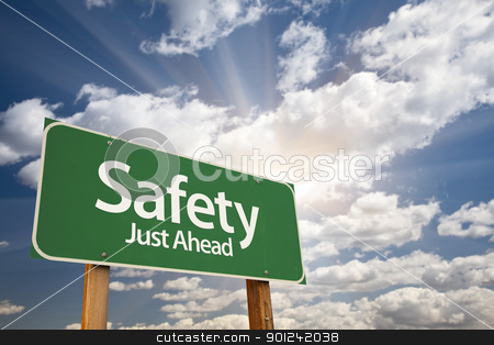 Safety, Just Ahead Green Road Sign stock photo, Safety, Just Ahead Green Road Sign Against Dramatic Sky, Clouds and Sunburst. by Andy Dean