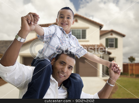 Hispanic Father and Son in Front of House stock photo, Playful Hispanic Father and Son in Front of Beautiful House. by Andy Dean