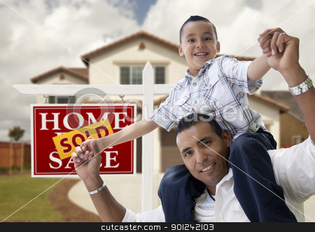Hispanic Father and Son in Front of House, Sold Sign stock photo, Happy Hispanic Father and Son in Front of New House and Sold Real Estate Sign. by Andy Dean