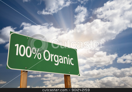 100% Organic Green Road Sign stock photo, 100% Organic Green Road Sign Against Dramatic Clouds, Sky and Sun Rays. by Andy Dean