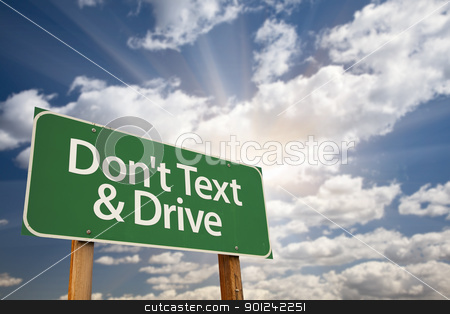 Don't text and Drive Green Road Sign stock photo, Don't text and Drive Green Road Sign with Dramatic Sky, Clouds and Sun. by Andy Dean