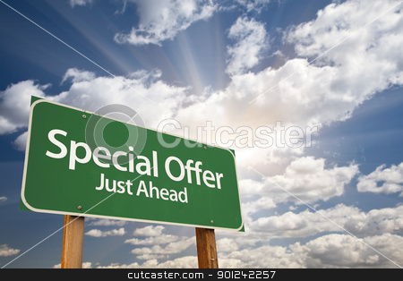 Special Offer Green Road Sign stock photo, Special Offer, Just Ahead Green Road Sign Over Dramatic Sky, Clouds and Sunburst. by Andy Dean