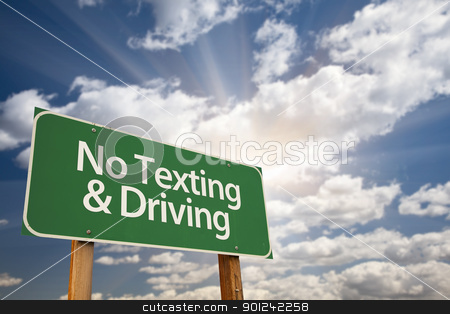 No Texting and Driving Green Road Sign stock photo, No Texting and Driving Green Road Sign with Dramatic Sky, Clouds and Sun. by Andy Dean