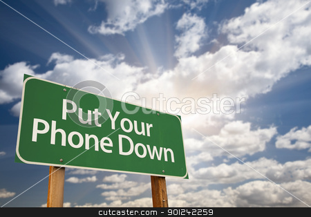 Put Your Phone Down Green Road Sign stock photo, Put Your Phone Down Green Road Sign with Dramatic Sky, Clouds and Sun. by Andy Dean