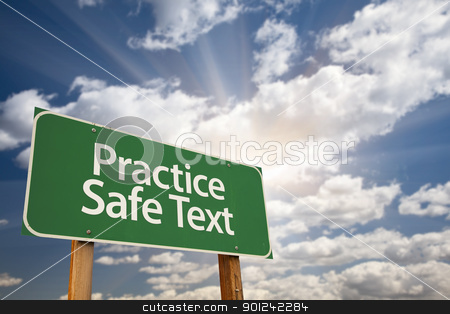 Practice Safe Text Green Road Sign stock photo, Practice Safe Text Green Road Sign with Dramatic Sky, Clouds and Sun. by Andy Dean