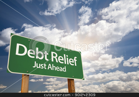 Debt Relief Green Road Sign stock photo, Debt Relief, Just Ahead Green Road Sign Over Dramatic Sky, Clouds and Sunburst. by Andy Dean